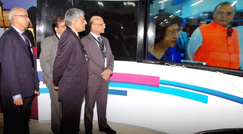 SBI officials during the launch of INTOUCH - bank's new digital branch in Bangalore on July 1, 2014.