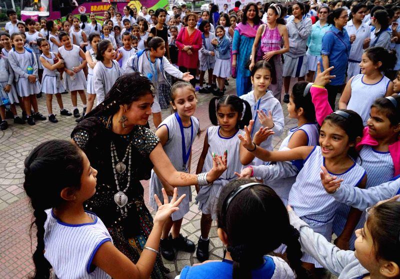 School children during the premiere of film `Dhanak` at Jio MAMI 17th Mumbai Film Festival in Mumbai on Oct 29, 2015.