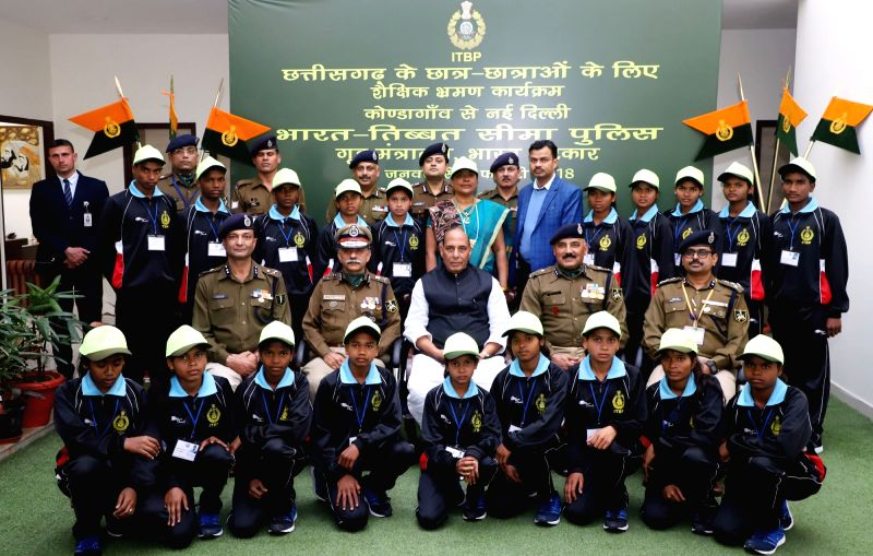 School children from Kondagaon district of Chhattisgarh during an excursion tour organised by ITBP in a group photograph with the Union Home Minister Rajnath Singh in New Delhi on Jan 31, ... - Rajnath Singh
