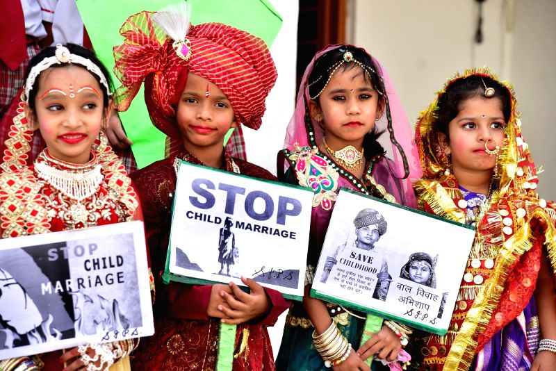 School children participate in an awareness campaign organised to stop child marriage on 'Akshaya Tritiya' in Bikaner of Rajasthan on April 27, 2017.