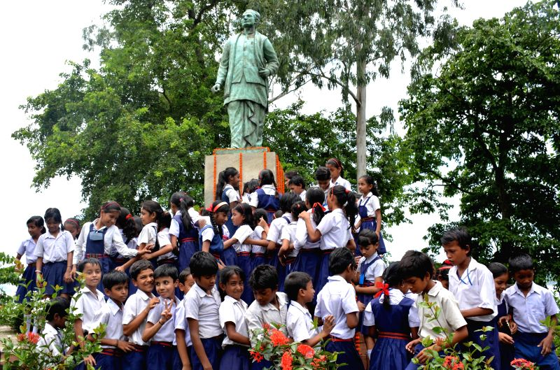 School children`s offer tribute to the statue of revolutionary cultural architect of Twentieth century Assam Rupkonwar Jyoti Prasad Agarwalla on his 111th birth anniversary celebration in Guwahati on