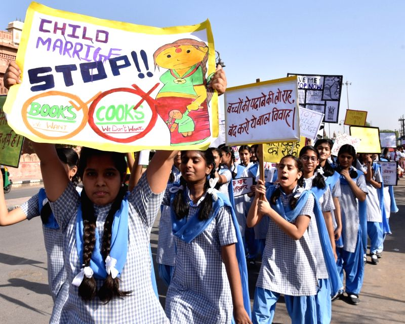 School children take part in an awareness campaign to stop child marriages in Bikaner, Rajasthan on April 13, 2018.