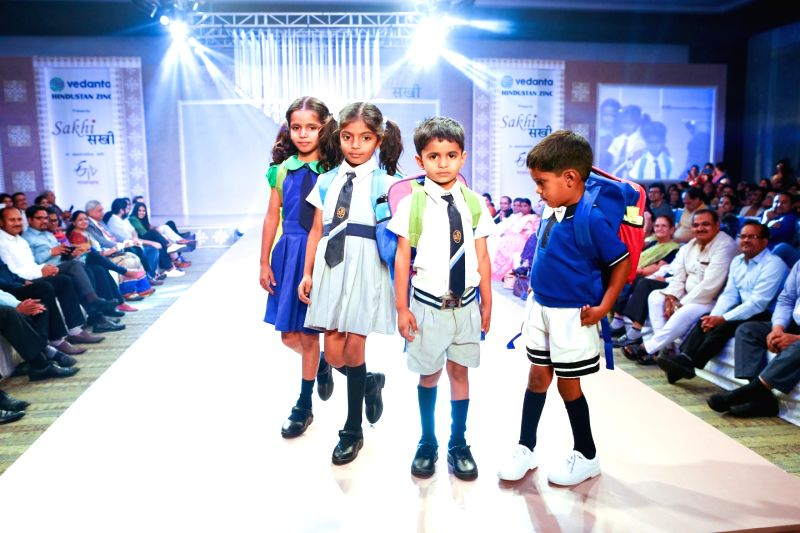 School children walking the ramp at a fashion show by Hindustan Zinc's rural women empowerment project Sakhi.