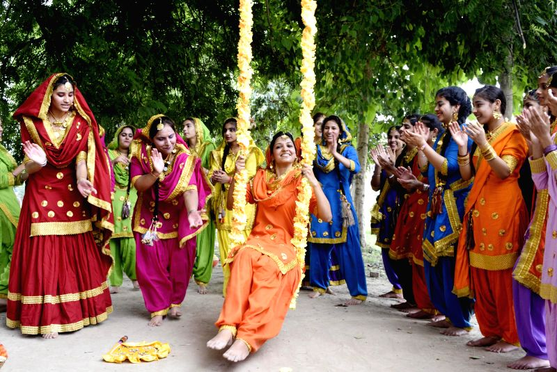 School Students and Staff Members during the Teej celebration in Amritsar on July 24, 2014.