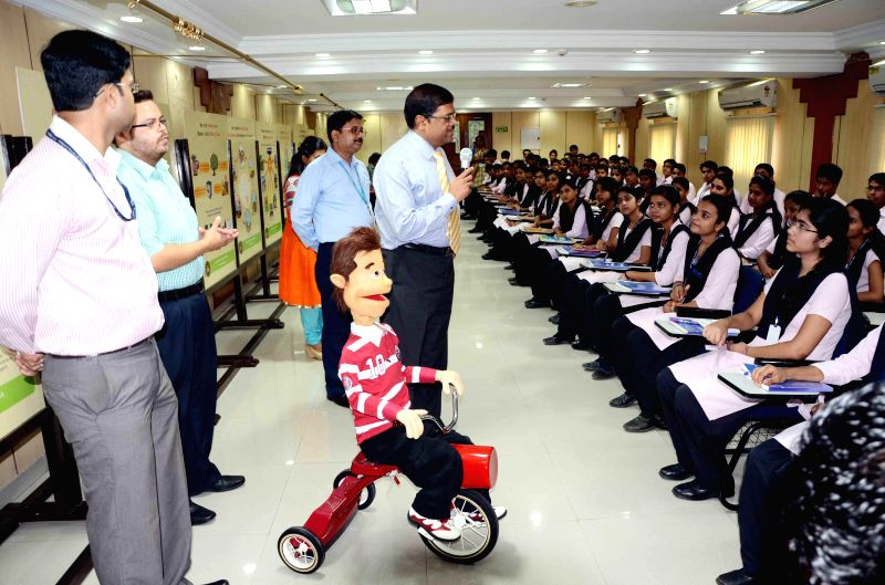 School students attend a workshop organised at Reserve Bank of India in Patna on Aug 27, 2014.