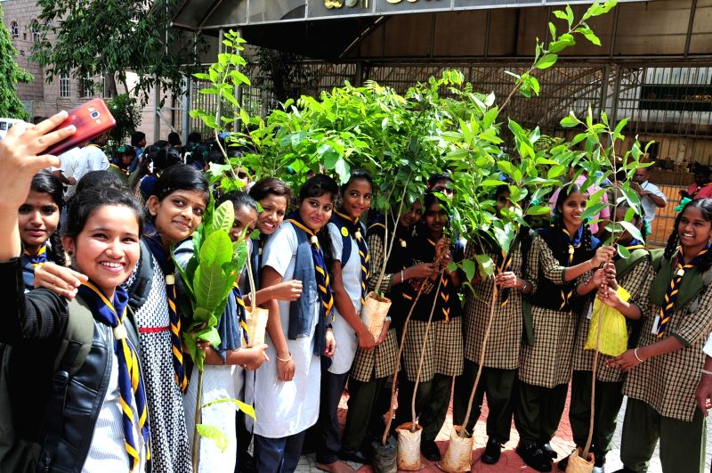 School students celebrate World Environment Day with saplings, in Bengaluru on June 5, 2018. June 5 is observed worldwide as World Environment Day.