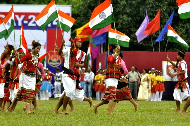 School students dance with India flags during 68th Independence Day celebrations in Agartala on Aug 15, 2014.
