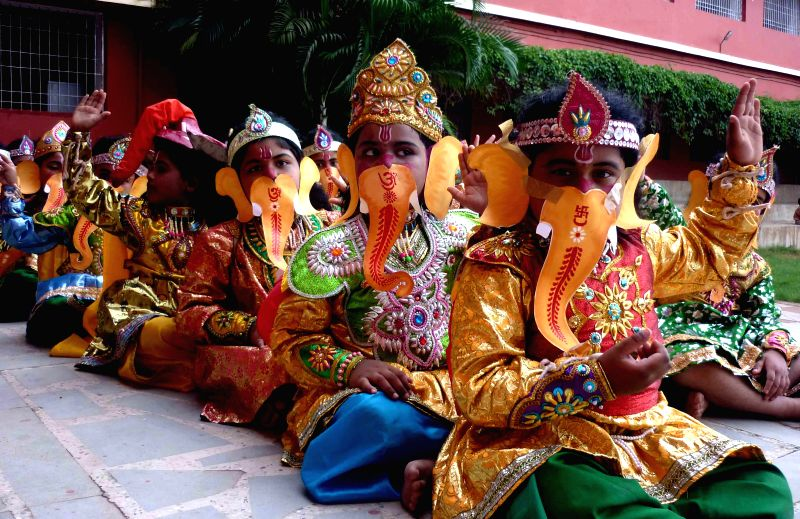 School students disguised as lord Ganesh during a programme ahead of Ganesh Chaturthi in Bhubaneswar on Aug 28, 2014. (Photo : Arabinda Mahapatra/IANS)