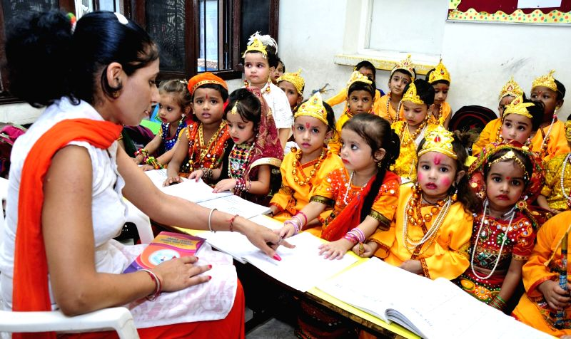 School students dress up as Lord Krishna and Radha ahead of Krishna Janmashtami in Amritsar on Aug 12, 2017.