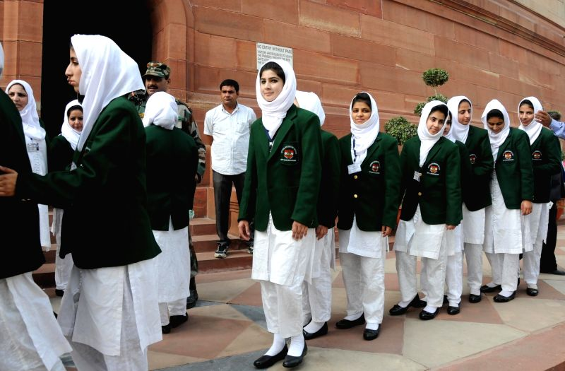 School students from Kashmir arrive visit the Parliament House in New Delhi, on Dec 8, 2015.