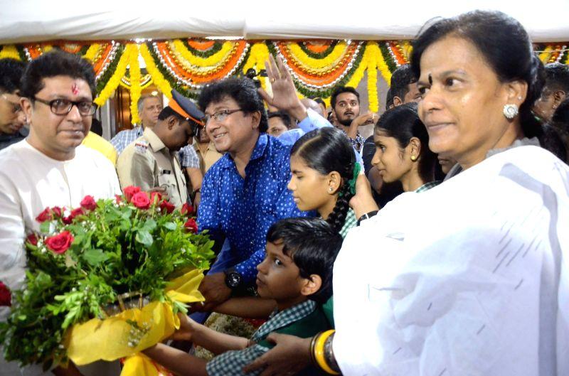 School students greet Maharashtra Navnirman Sena (MNS) President Raj Thackeray on his birthday at his residence in Dadar, Mumbai on June 14, 2018.