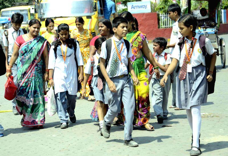 School students inconvenienced as autorickshaw drivers go on strike in Patna on Sept 4, 2014.