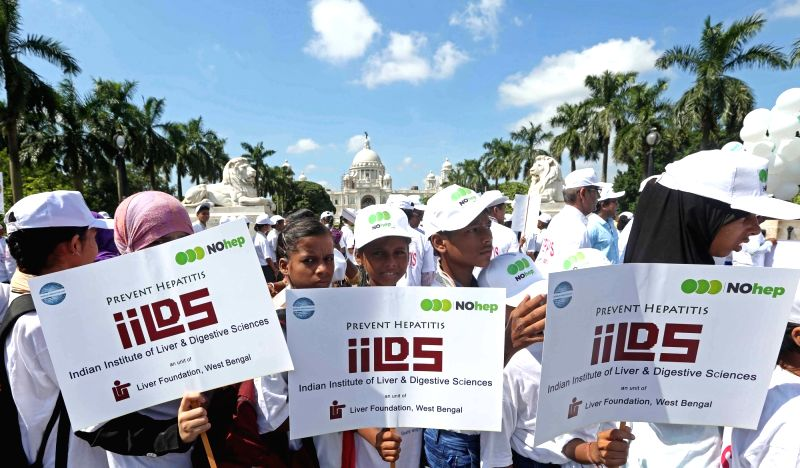 School students participate during a Hepatitis Awareness Rally on the occassion of World Hepatitis Day in Kolkata on July 28, 2016.