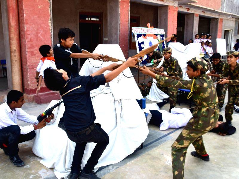 School students participate during a programme organised to celebrate Kargil Vijay Diwas in Bikaner, on July 26, 2016.