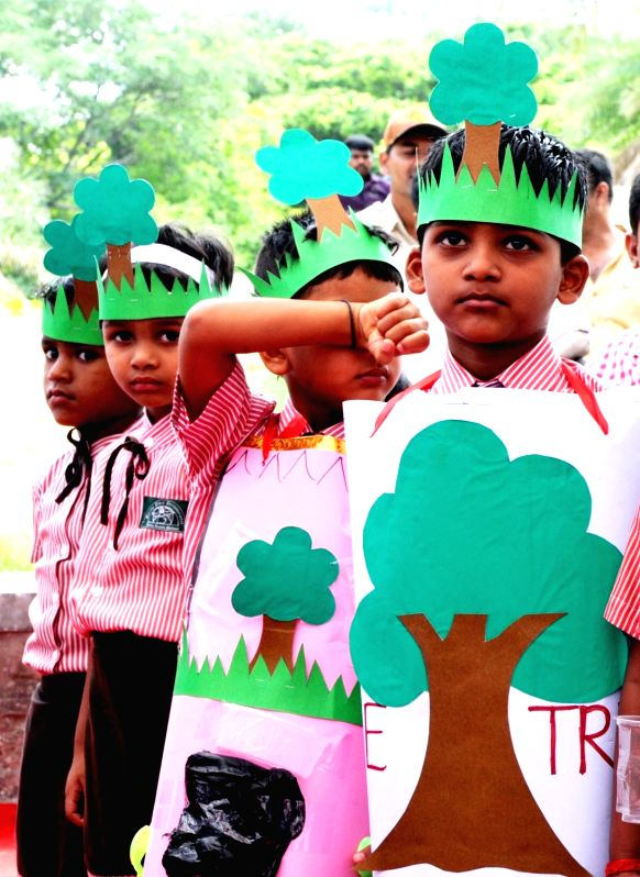 School students participate during a programme organised on World Environment Day in Bengaluru on June 5, 2017.