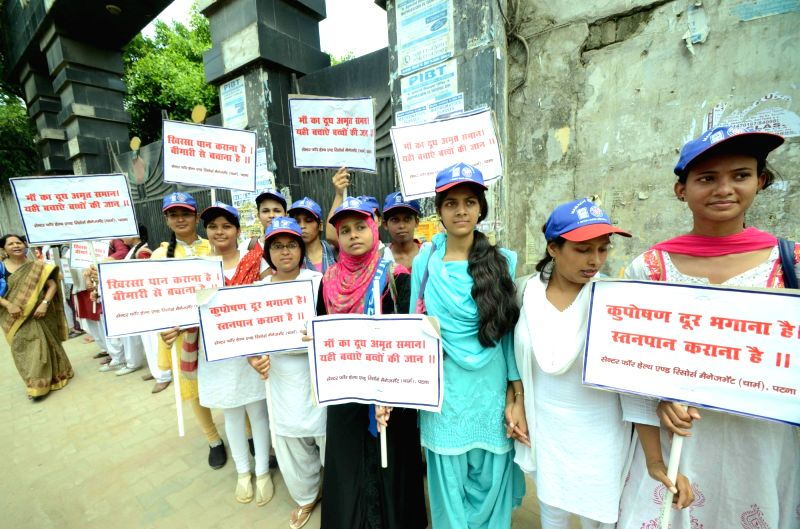 School students participate during an awareness campaign rally on the occassion of World Breastfeeding Week 2016 in Patna on Aug. 6, 2016.