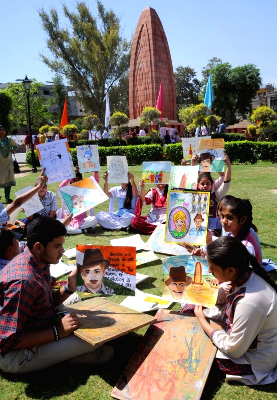 School students participate in a painting competition organised at the Jaillanawala Bagh on the 99th anniversary of the Jallianwala Bagh massacre, in Amritsar on April 13, 2018.