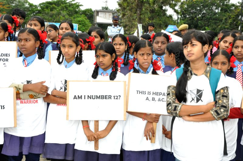 School students participate in an awareness rally organised on World Hepatitis Day in Hyderabad July 28, 2014.