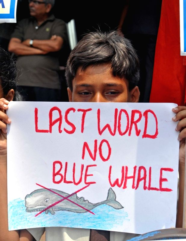 """School students participate in an awareness rally on suicide video game - """"Blue Whale"""" on World Suicide Prevention Day in Kolkata on Sep 10, 2017."""