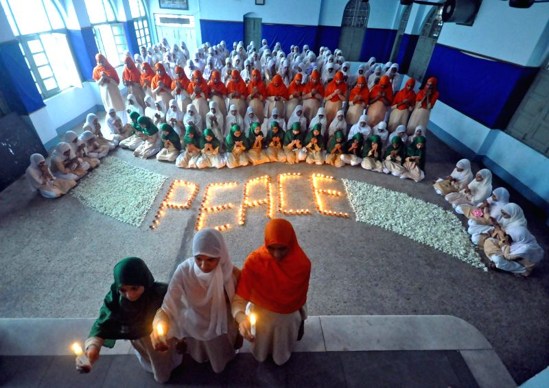 School students pay tribute on the occassion 71st anniversary of U.S. atomic bombing in Hiroshima and Nagasaki;  in Ahmadabad on Aug 9, 2016.