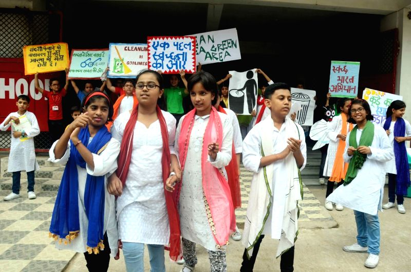 School students perform a street play during the Swachh Bharat Mission awareness campaign in Patna on Aug 8, 2016.