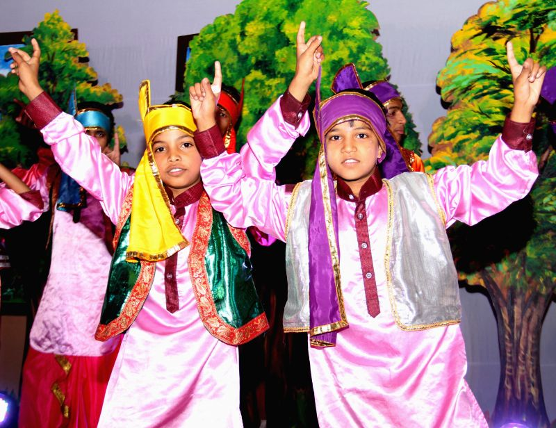 School students perform during a programme organised by Education department of NDMC at Talkatora Stadium in New Delhi on April 29, 2014.