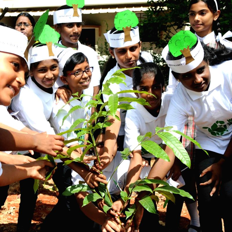 School students plant a sapling on World Environment Day in Bengaluru on June 5, 2017.