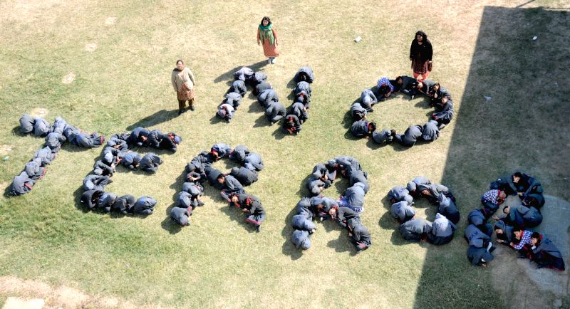 "School students  sit in the formation reading ""No Terror"" to condemn 13/11 Paris attacks in Amritsar, on Nov 17, 2015."
