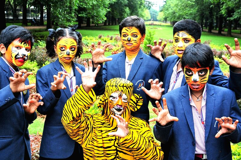 School students spread awareness about the declining population of tigers, on the eve of International Tigers Day, in Bengaluru on July 28, 2018.