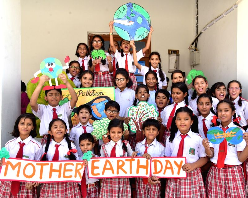 "School students spreading message through paintings for saving environment on the eve of ""World Earth Day"" in Bikaner on April 20, 2017."