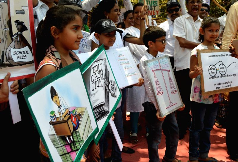 School students stage a demonstration at Azad Maidan  against hike in school fees in Mumbai on April 20, 2017.