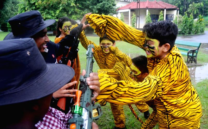 School students wearing bodysuits resembling tigers celebrates Global Tiger Day at Alipore Zoological Garden in Kolkata on July 29, 2016.
