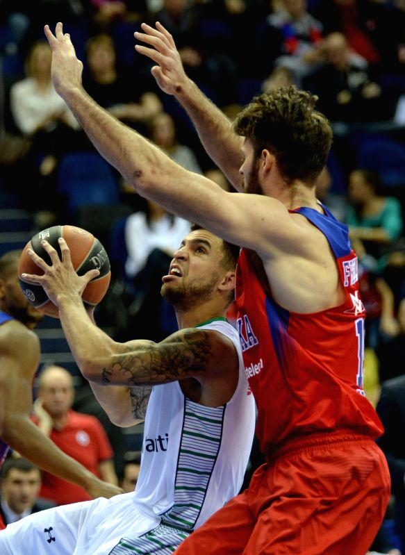 Scottie Wilbekin (L) of Darussafaka Dogus Istanbul goes to the basket during the Euroleague basketball match between Russia's CSKA Moscow and Turkey's Darussafaka ...