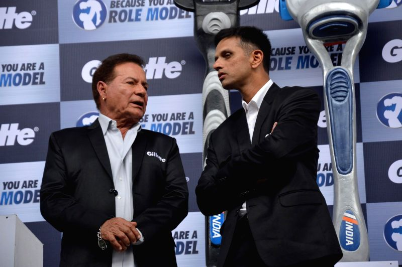 screenwriter Salim Khan speaks with Indian former cricketer Rahul Dravid during an event organized to celebrate a nationwide campaign `Because You Are A Role Model` by Gillette in Mumbai on June ... - Rahul Dravid and Khan