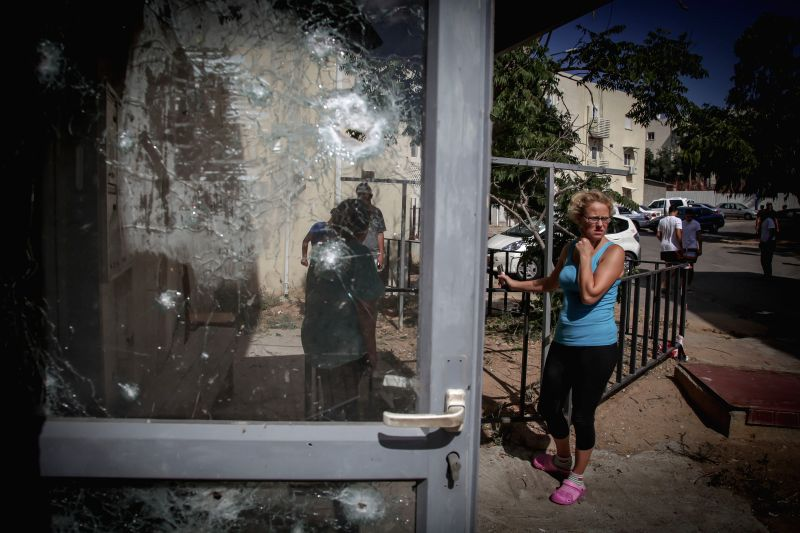 SDEROT (ISRAEL), July 15, 2014 The damage on a door is seen caused by a rocket fired from Gaza Strip in Sderot, southern Israel bordering Gaza Strip, on July 15, 2014. The Israeli army on