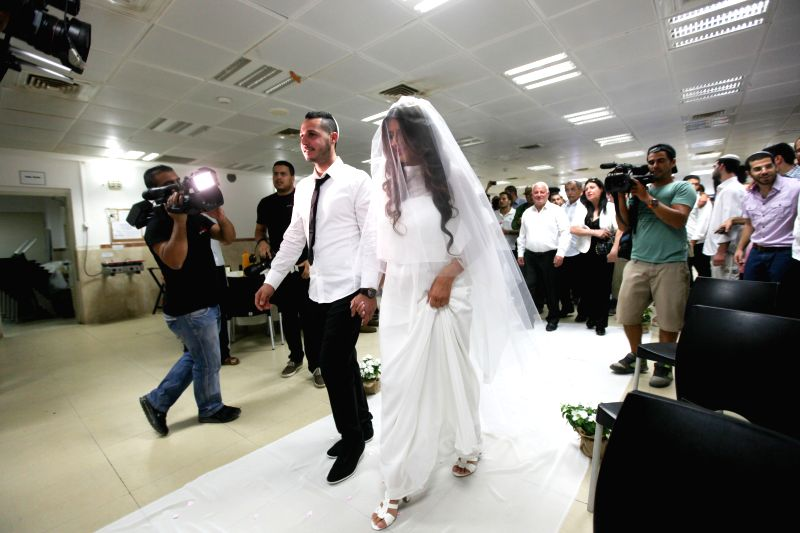 SDEROT (ISRAEL), July 16, 2014 Israeli bride Zohar and her groom Haim are seen at their wedding party in a bomb shelter of the Yeshva (religious school) in Sderot, southern Israel ...