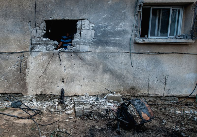 SDEROT (ISRAEL), July 21, 2014 A man inspects the damage of a house, following following a rocket attack by militants from Gaza, in Sderot, southern Israel bordering Gaza Strip, on July ..