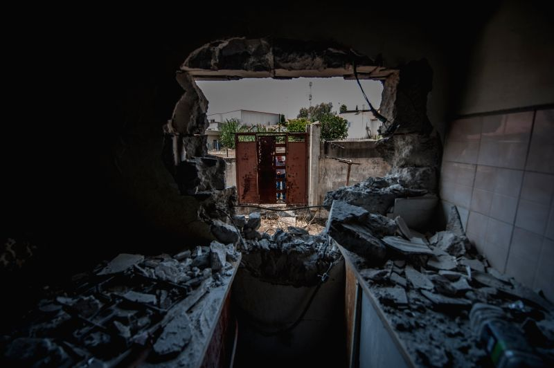 SDEROT (ISRAEL), July 21, 2014 A man takes photographs of the damage of a house, following a rocket attack by militants from Gaza, in Sderot, southern Israel bordering Gaza Strip, on July