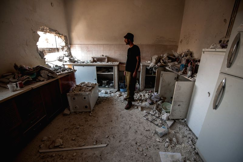 SDEROT (ISRAEL), July 21, 2014 An Israeli man inspects the damage of a house, following a rocket attack by militants from Gaza, in Sderot, southern Israel bordering Gaza Strip, on July ...