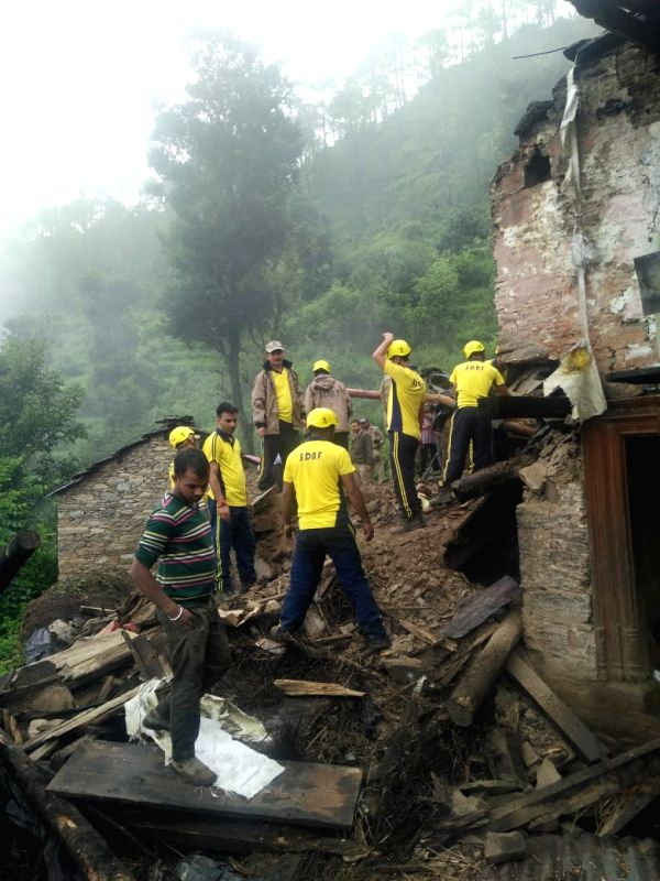 SDRF personnel carry out rescue operations at the site of cloud burst in Sonali village of Uttarakhand's Chamoli district on Aug 5, 2018.