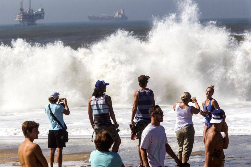 SEAL BEACH (U.S.), Aug. 28, 2014 People watch huge waves brought by Hurricane Marie at Seal Beach in California, the United States, Aug. 27, 2014. The homes at oceanfront in Seal Beach ...