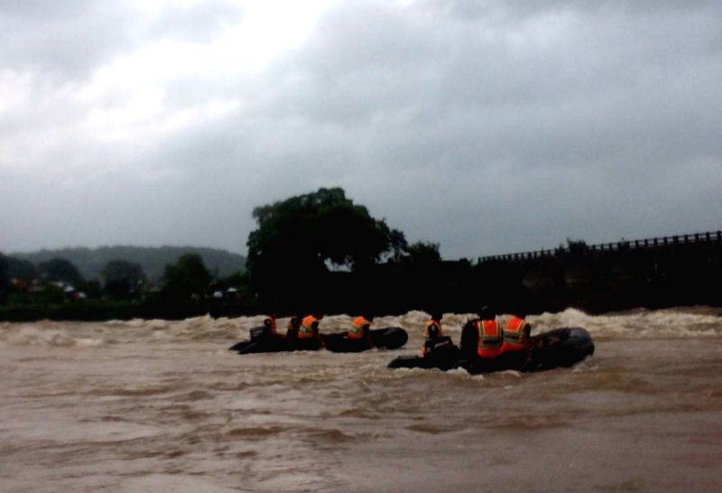 Search operations underway at the site where at least two buses with about 22 passengers were washed away in flood waters after a bridge collapse on the Mumbai-Goa Highway  in Raigad of ...