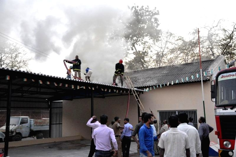Firefighters try hard to douse a fire that broke out at Secunderabad Cantonment Board Workshop and Stores Department Mudfort on Feb 18, 2015.