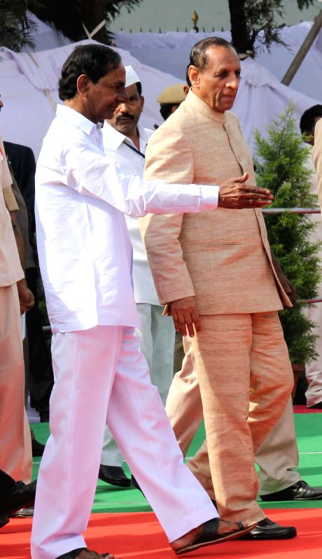 Telangana Chief Minister K Chandrasekhar Rao and Telangana Governor ESL Narasimhan arrive to participate in Republic Day celebrations at Secunderabad Parade Ground on Jan 26, 2015. - K Chandrasekhar Rao