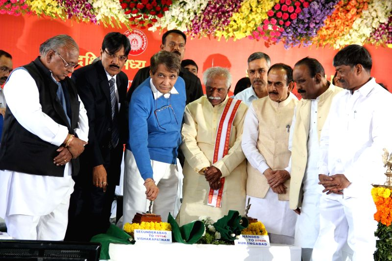 Union Railway Minister Suresh Prabhakar Prabhu flags-off a train connecting Secunderabad to Visakhapatnam in Secunderabad, on Jan 19, 2015. - Suresh Prabhakar Prabhu