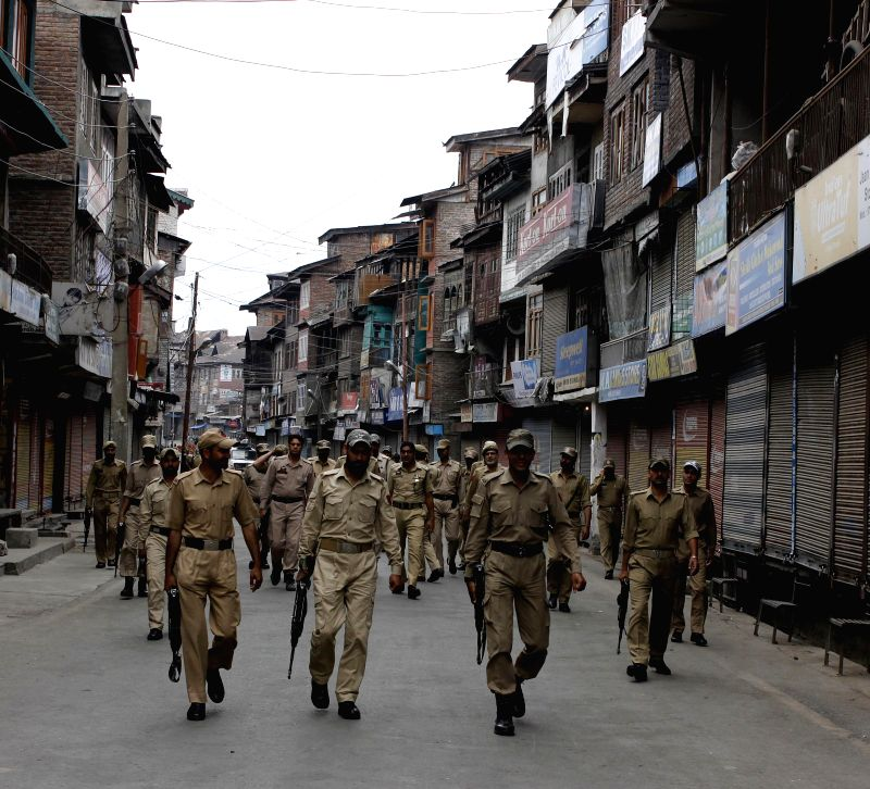 Security beefed-up in Srinagar to thwart the 'Lal Chowk Challo' rally called by JKLF chairman Mohammad Yasin Malik to start his 'Quit Kashmir' movement on June 23, 2014. - Malik