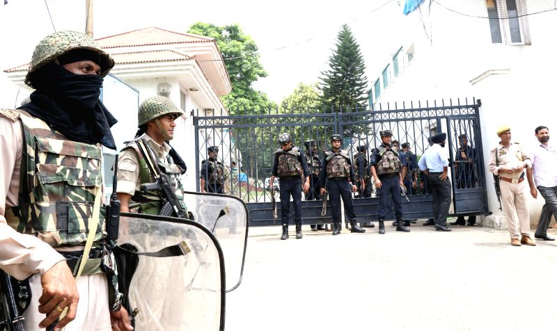 Security beefed up outside former Jammu and Kashmir Chief Minister Farooq Abdullah's residence after an intruder was shot dead by security guards for breaching security; in Jammu on Aug 4, ... - Farooq Abdulla and Morifat Khan