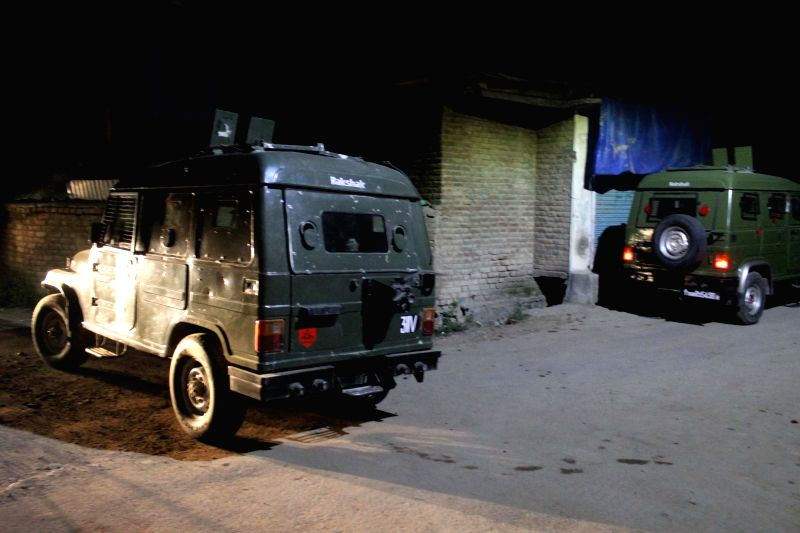 Security beefed up outside Justice (Retd.) Muzaffar Attar's residence after militants attacked security personnel outside his residence and fled away with their arms in Anantnag on June 13, ...