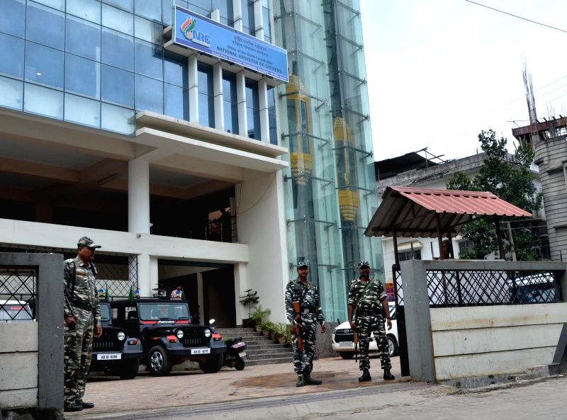 Security beefed up outside National Register of Citizen (NRC) state coordinator's office  ahead of publication of the draft NRC in Guwahati on July 29, 2018. The Assam government have drawn ...