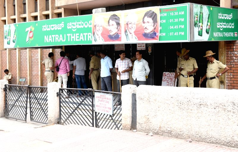 Security beefed-up outside the Nataraj Theatre as Kannada movies being stalled in Tamil Nadu, in Bengaluru on April 22, 2017.